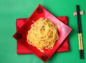stock photo of carbonara  - spaghetti carbonara served on a green blackground - JPG