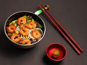 pic of rice noodles  - Vietnamese shrimp and rice noodles soup pho on a black background - JPG