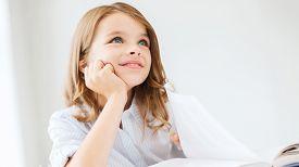 foto of little school girl  - education and school concept  - JPG