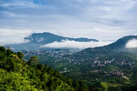 picture of himachal  - Clouds rolling between the hills of himachal pradesh in India - JPG