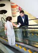 Bridegroom And Bride On Escalator