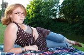 pic of clevage  - a beautiful redhead with glasses and a cute smile - JPG