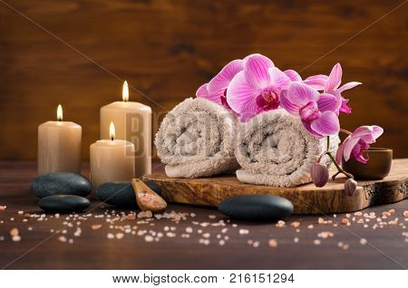 Spa setting with brown rolled
