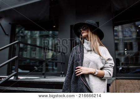 poster of Portrait Of A Young Beautiful Fashionable Girl Wearing Sunglasses. Model In A Stylish Black Hat. Har