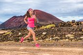 Trail run ultra runner sport woman running training cardio on rocky mountain path on long distance e poster