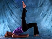 Woman In One Leg Bridge Yoga Pose
