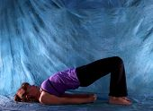 Woman In Yoga Bridge Pose