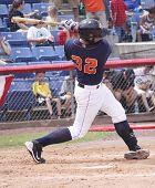 Binghamton Mets batter Dusty Ryan takes a big swing