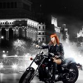 red-haired girl on a motorbike