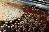 image of chug  - Bubbles rise on a glass of cola - JPG