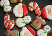 stock photo of christmas cookie  - On a baking tray the christmas cookies are ready to taste - JPG