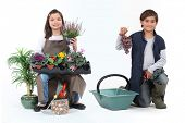 little girl dressed in florist and a little boy dressed in grape harvester