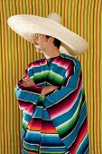 Mexican typical poncho man with sombrero and mustache over yellow background