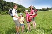 Family rambling in country field