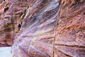 Multicoloured Sandstone Walls Of Gorge Siq In Petra,