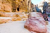 Eroded Sandstone Rocks And Clored Montains In Gorge Siq