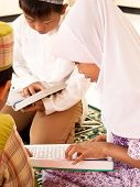 Children Reading Koran