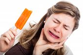 Woman With Hypersensitive Teeth Eating Ice Lolly