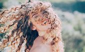 Beauty Girl. Blonde Spring Girl With Curly Beautiful Hair Smiling. Beauty Hair Salon. Fashion Haircu poster