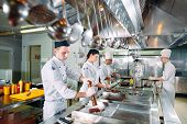 Modern Kitchen. The Chefs Prepare Meals In The Restaurants Kitchen poster
