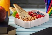 School Lunch In A Box, Berries, Nuts And A Sandwich. Almonds, Red Currants And Blueberries For A Chi poster