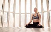 Beautiful Woman Coach Yoga Practice. Yoga Concept. Swastikasana, Seated Yoga Pose poster