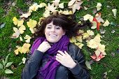 Pretty Young Girl Lying In Autumn Leaves