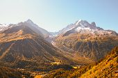 Beautiful Sunset Over The Mountains In French Alps Near Chamonix. Snow Capped Mountains In Backgroun poster