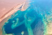 Aerial View Of Turquoise Sea Coast And Sandy Beach poster