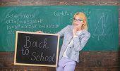 Beginning Of New School Season. Teacher Welcomes School Year. Woman Teacher Holds Blackboard Inscrip poster