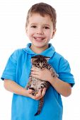 Smiling boy with kitty in hands