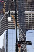 New York - Oct 8: A Sign At Vesey Street With The Freedom Tower Behind As Construction Continues O