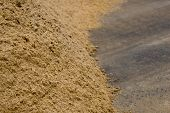 image of banquette  - Hill of yellow sand on asphalt homogeneous structure - JPG