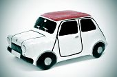 closeup of a papier-mache toy car