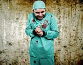Crazy surgeon waiting for a new patient