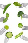 Border Of Fresh Green Vegetables Isolated On Forks