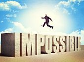 picture of impossible  - man jump over impossible concrete word - JPG