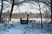 Snowy Forest Path And A Wooden Gate In The Background