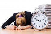 Woman businesswoman with giant alarm clock