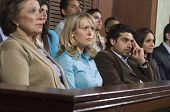 stock photo of jury  - Group of multi ethnic business people sitting at court house - JPG