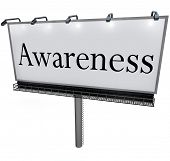 The word Awareness on a large outdoor billboard advertising sign to represent marketing, communicati