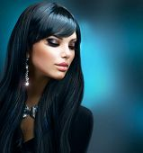 Beautiful Brunette Girl. Healthy Long Hair and Holiday Makeup. Jewelry. Jewellery