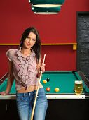 Leaning Against A Pool Table