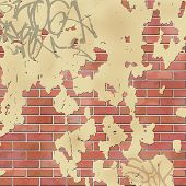 An Old Brick Wall with Peeling Plaster and Graffiti