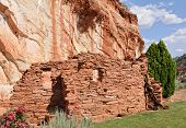 Ancient Wall Under Rock