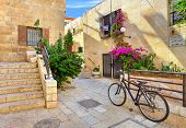 Bicycle on narrow street among typical stoned houses of jewish quarter in Old City of Jerusalem, Isr