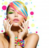 Beauty Girl Portrait with Colorful Makeup, Hair, Nail polish and Accessories. Colourful Studio Shot of Stylish Woman. Vivid Colors. Manicure and Hairstyle. Rainbow Colours