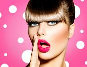 Surprised Woman with open Mouth. Pin up Girl. Make up. Beauty Woman over Pink Background. Open Mouth