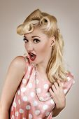 Pin-up Style Portrait Of Surprised Blonde Woman