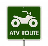 foto of four-wheeler  - An American road sign isolated on white with a symbol of an ATV and words ATV Route Places to ride ATV - JPG